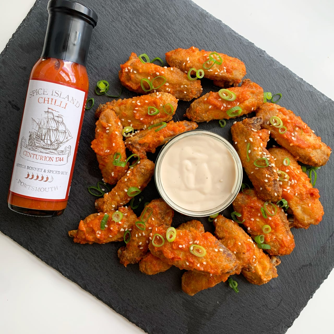 Crispy fried scotch bonnet & spiced rum chicken wings with a blue cheese dip