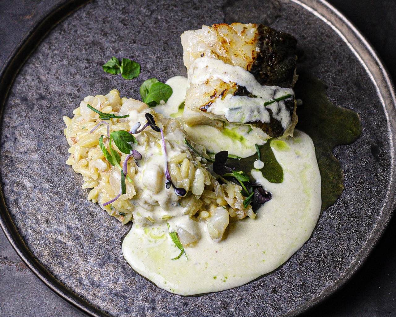 Roasted Cod Loin with Queen scallop and Crab Orzotto