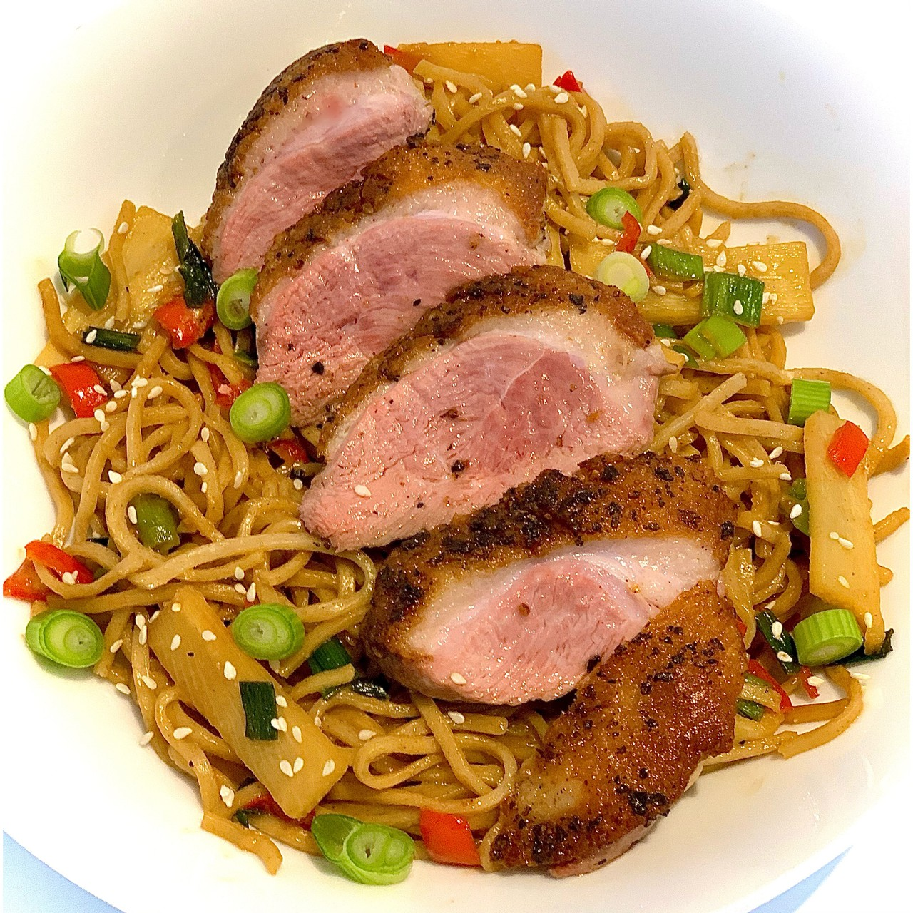 Duck breast served with Chinese style wholewheat noodles