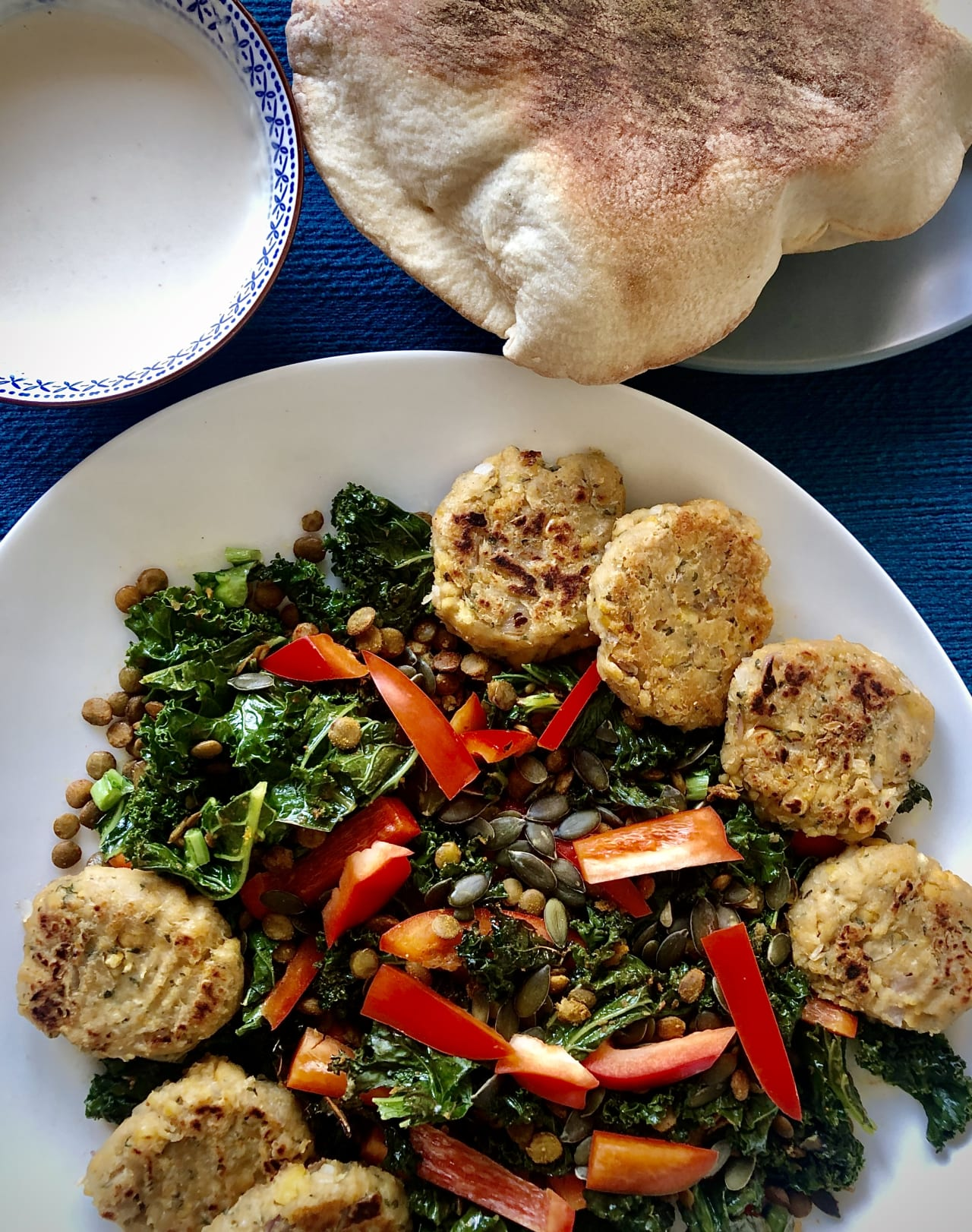 Chickpea Patty, Baked Kale and Spiced Lentil Salad with a Tahini Dressing