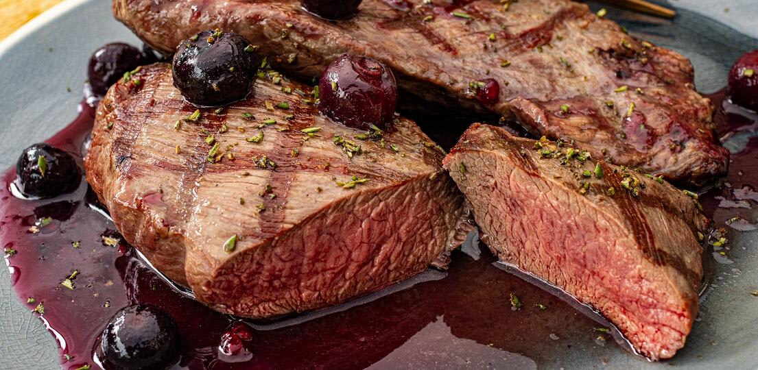 Grilled Venison steak from the BBQ with red port sauce