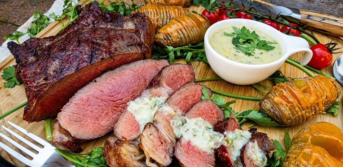Cowboy steak from the grill with blue cheese sauce